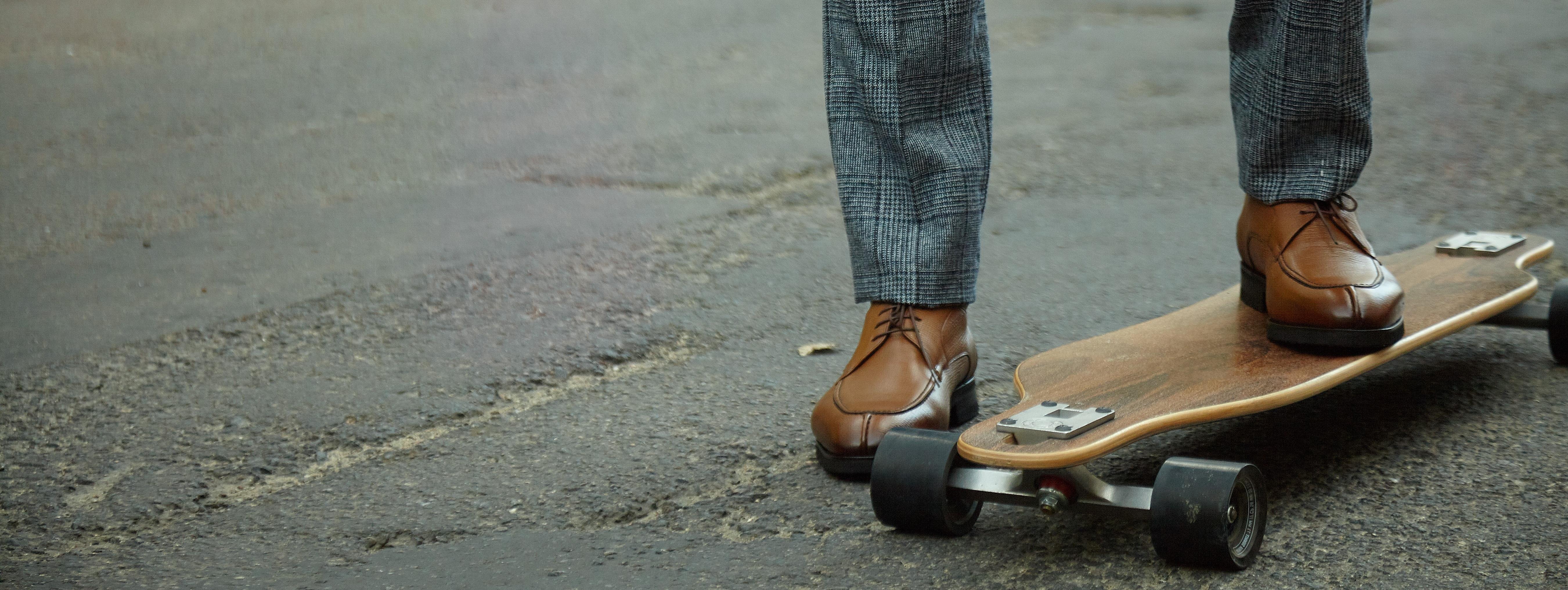 Businessman riding a wooden skateboard