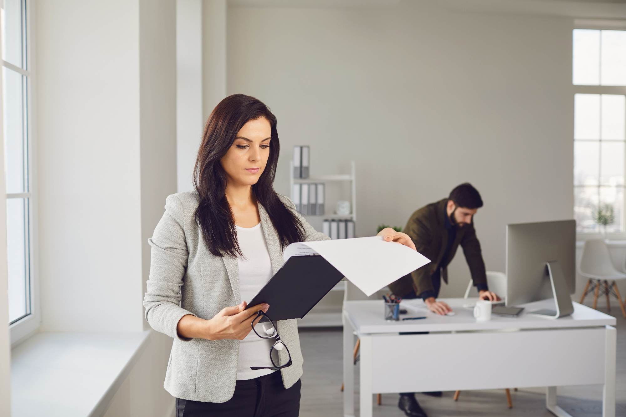 Woman holding a clipboard in an office