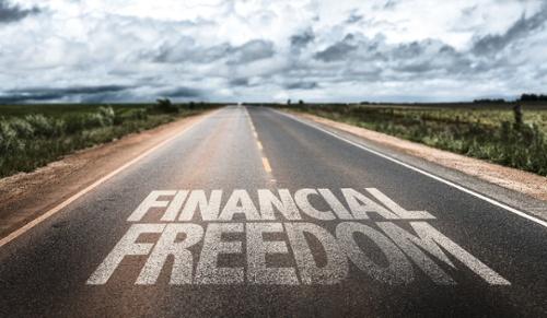 Financial Freedom written on rural road-1-1