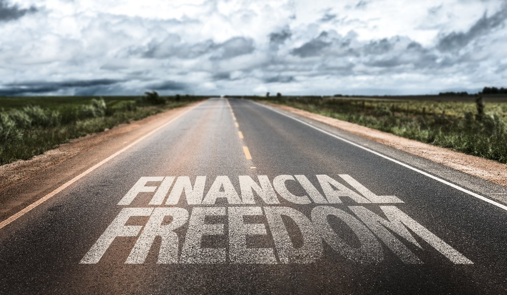 Financial Freedom written on rural road